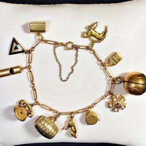 Jewelry - Vintage 14k gold charm bracelet, 11 charms